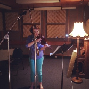 Tessa Petersen recording the violin part
